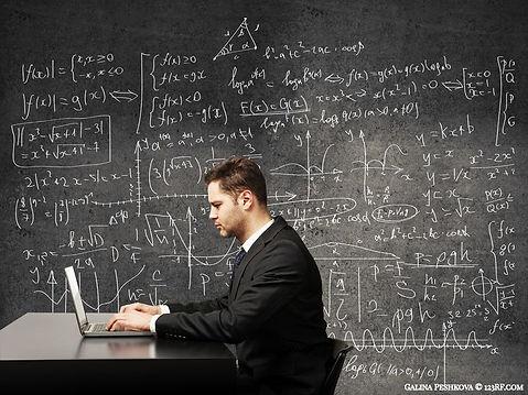 businessman in front of formulas