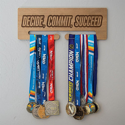 Decide, Commit, Succeed Medal Display