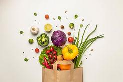top-view-assortment-vegetables-paper-bag