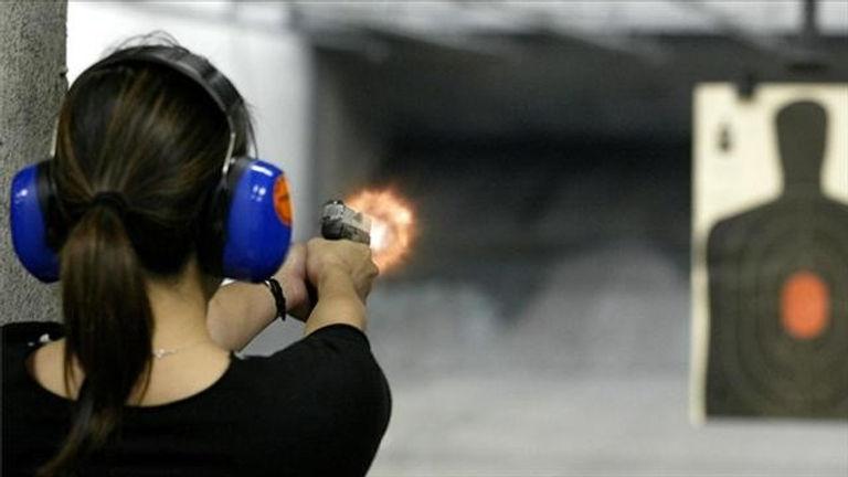b2ap3_large_woman-at-gun-range.jpg