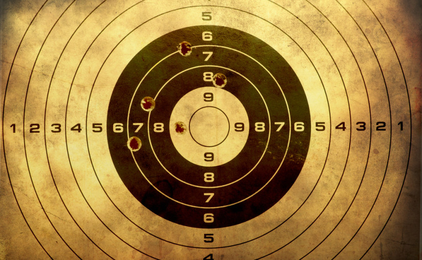 Target-full-of-bullet-holes-at-the-Sevier-Indoor-Shooting-Range-in-the-Smoky-Mountains-825x510