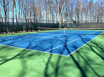 Cushioned tennis court with stone base