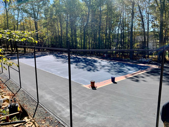 Court has been resurfaced and the first coat of paint is down