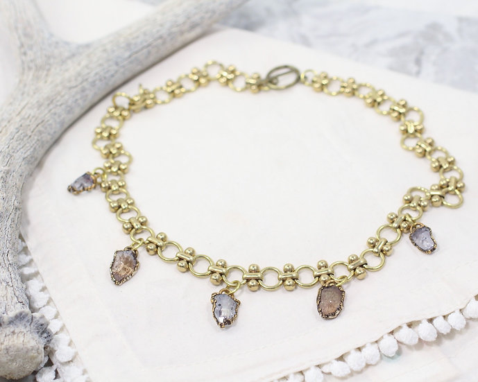 Sherry color and clear Topaz charm necklace