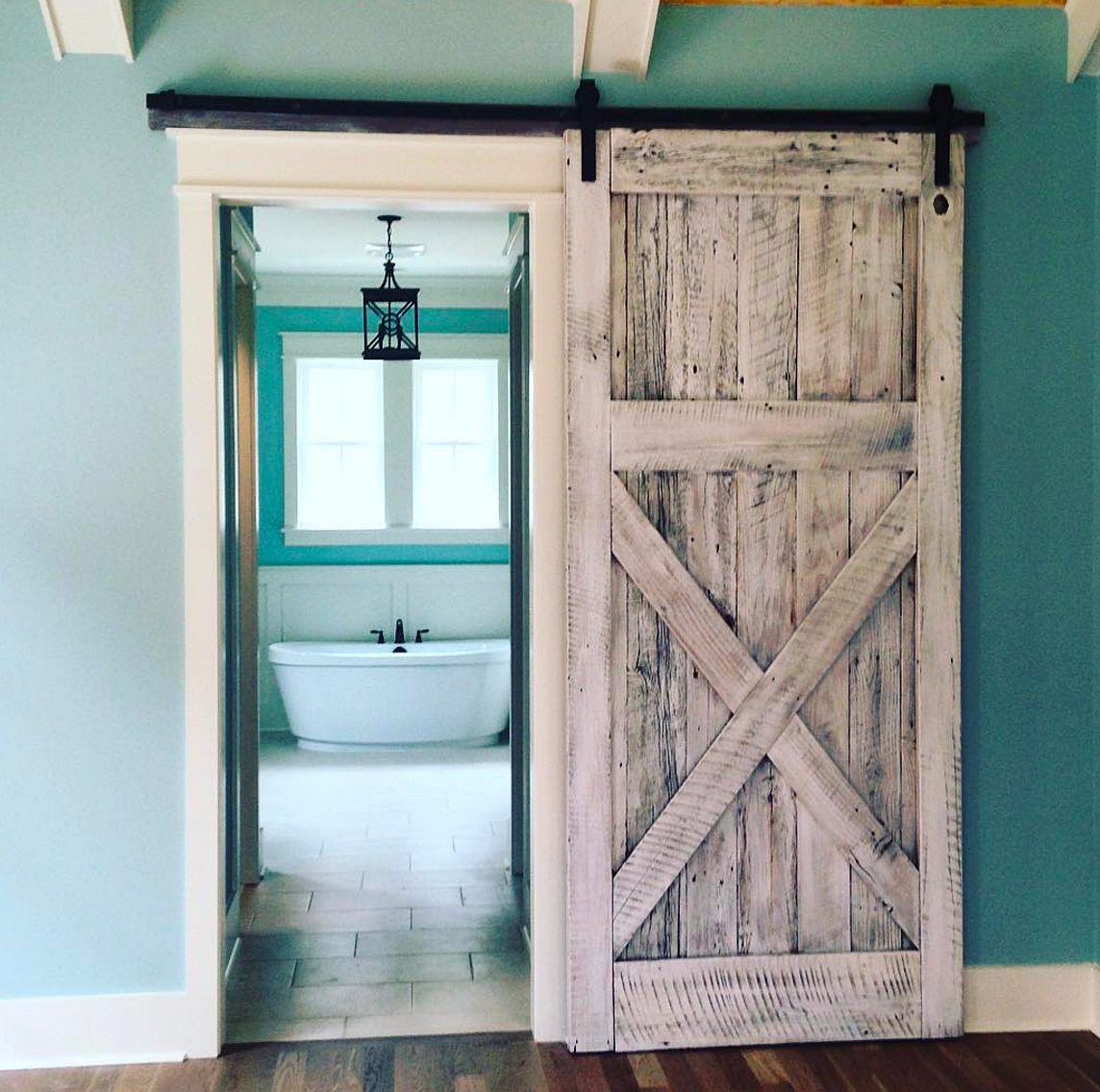Sliding barn door made from authentic, reclaimed oak barn wood in Charleston,  SC and finished with a white lime wash. - Salt Wood Co. - Custom Reclaimed Wood Furniture In Charleston, SC
