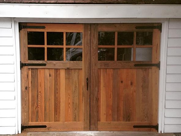 Reclaimed sinker cypress garage doors. Handmade in Charleston, SC.