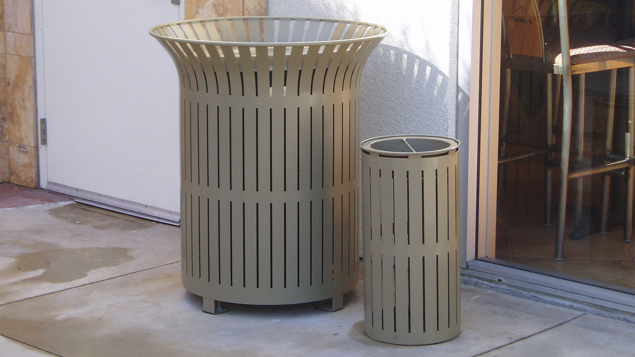 metal litter receptacle and ash urn together outside in front of wall by entrance