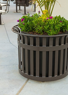 metal planter with flowers outdoors