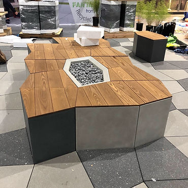 close up of geoemtric wooden public furniture bench with fire pit