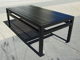 metal coffee table sitting outside