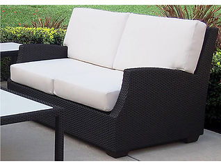 close up of wicker love seat outdoors