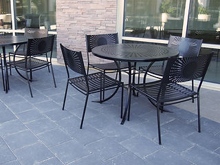 black dining table and chairs sitting outside