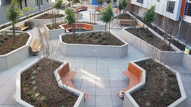 outdoor concrete planters with wood benches furniture in urban space