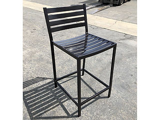 black metal dining chair outside on concrete