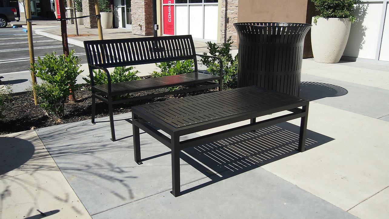 black metal furniture seating and table outside on sidewalk