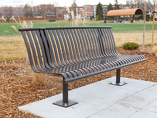 metal bench sitting outdoors in park