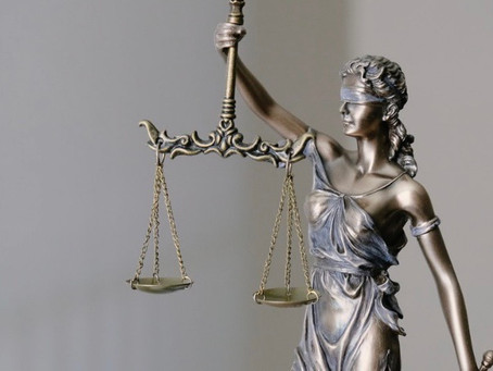 """America awaits its """"report card"""" on justice."""