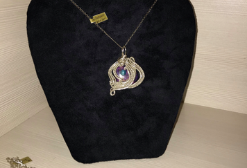 Sterling silver wrapped charoite stone w
