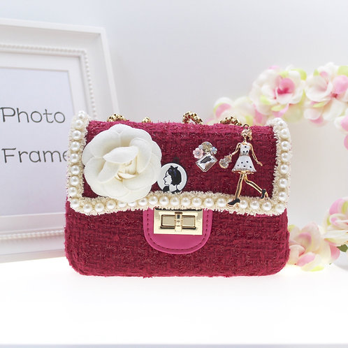 Cerise Cute tweed bag with hand and shoulder gold chain.