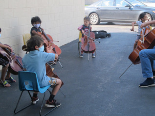 Young cellists play outdoors!