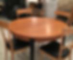 table ronde avec rallonge intégrée