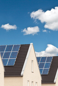 Canva-Row-of-New-Houses-with-Solar-Panels-scaled.jpg