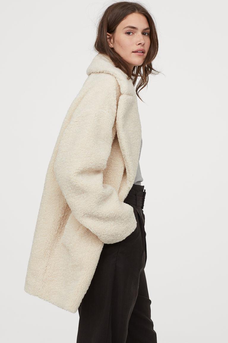 manteau court en peluche crème