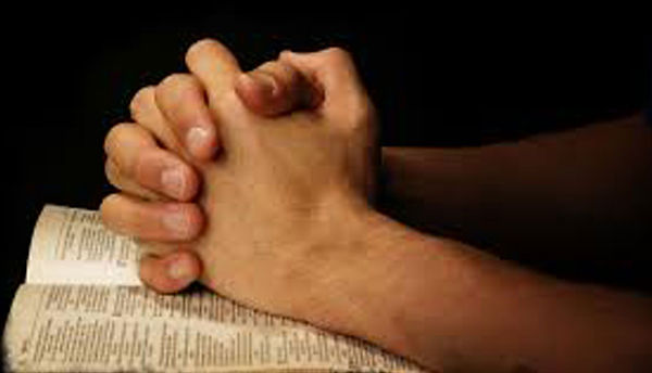 praying-hands-on-bible.jpg