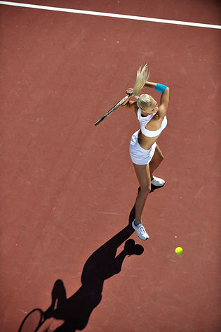 young-woman-play-tennis-outdoor-PDE8BUV.