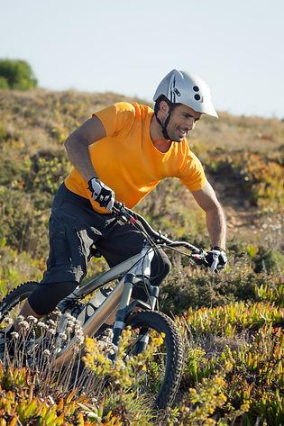mountain-biker-riding-dirt-trail-P5S8DJC