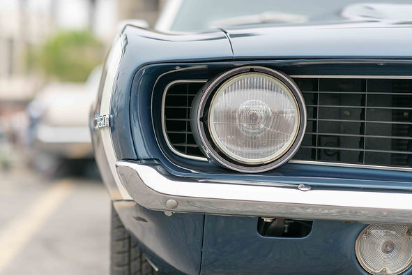 close-up-of-vintage-old-car-with-faded-c