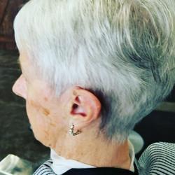 Woman clipper cuts ..
