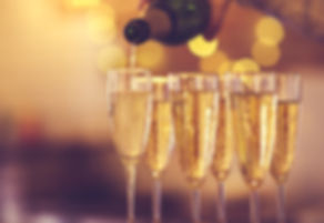 Champagne glasses on gold background. Pa