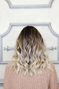 Beautiful woman with balayage hairstyle