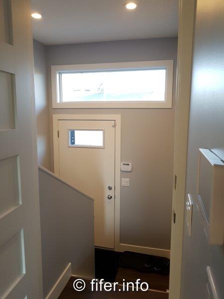 Rear entry. Transom window.