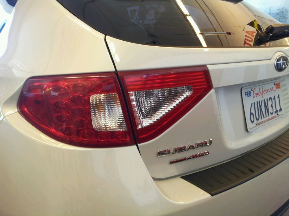 Subaru tail lights red with hand cut clears