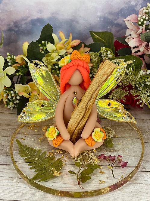 Palo Santo Holding Yellow Fairy
