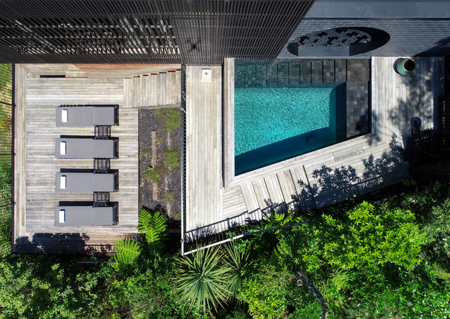 waiheke island lantern house holiday rental accomodation - top view pool sun beds tanning nature herbst architects