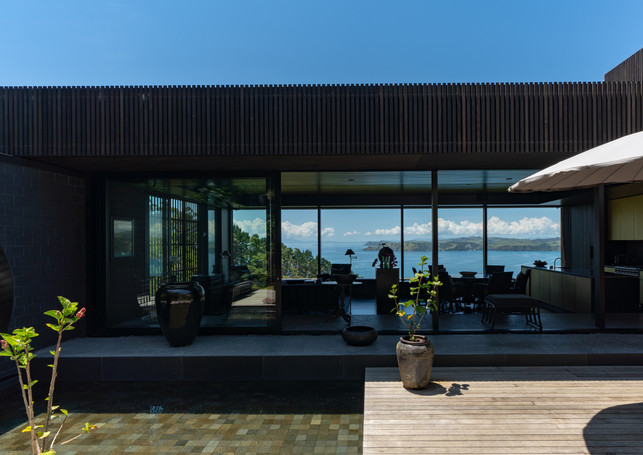 waiheke island lantern house holiday rental accomodation - outdoor ocean sea view deck courtyard