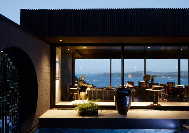 waiheke island lantern house holiday rental accomodation - pool pond night sea view ocean asian eastern design