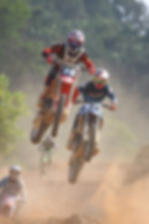 Canva - Two People Riding on Dirt Bike.j