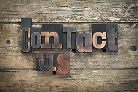 """phrase """"contact us"""" written with vintage"""