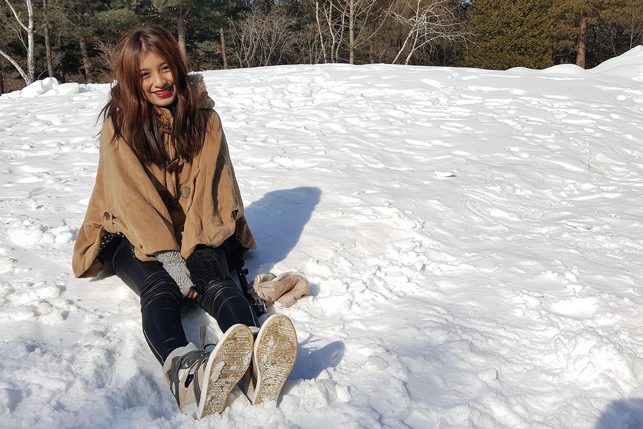 Sitting on dazzling white snow