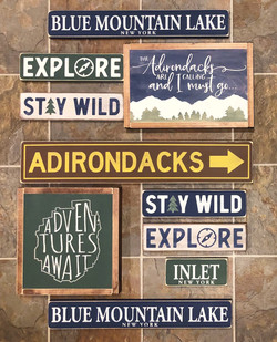 A collection of Adirondack-themed signs.