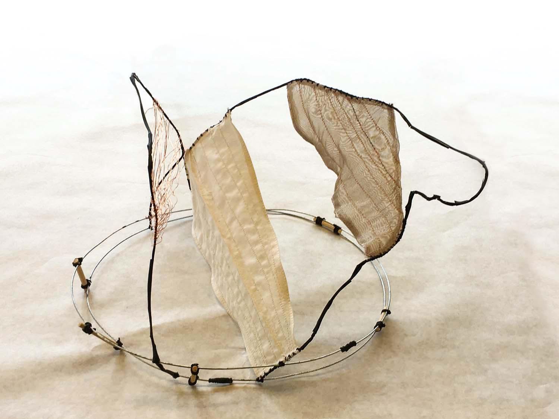 Weaving Steel •Sculpturing Silk