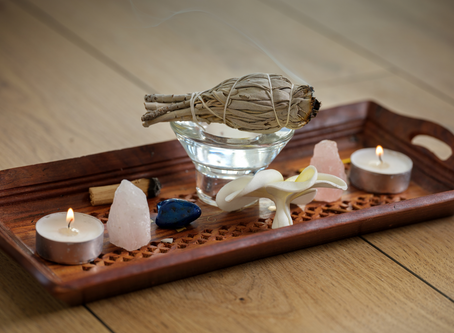 Utilizing cleanse crystal, smudging, and burning sage