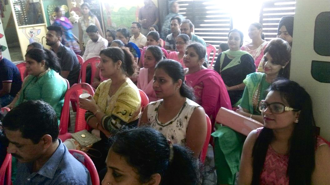 Parents listening to talk on Know your child