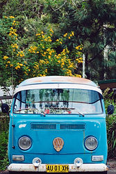 front of blue VW camper