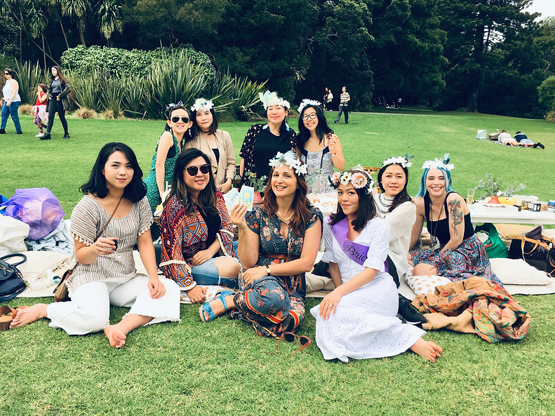 Hen party guests from Melbourne with Julia Madotti in the park performing a tarot reading