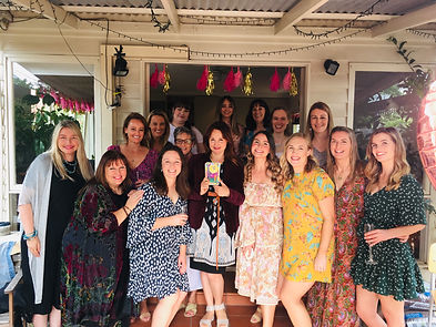Julia tarot reader with the guests and hen at classy hens party in Melbourne